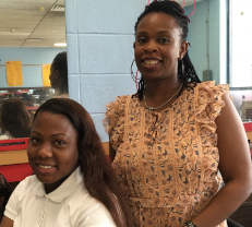 Cosmetology Academy student posing with a teacher.