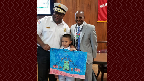 Photo of Dr. Winston Jackson with the Chancellor Avenue School Contest Winner and the Essex County Fire Chief