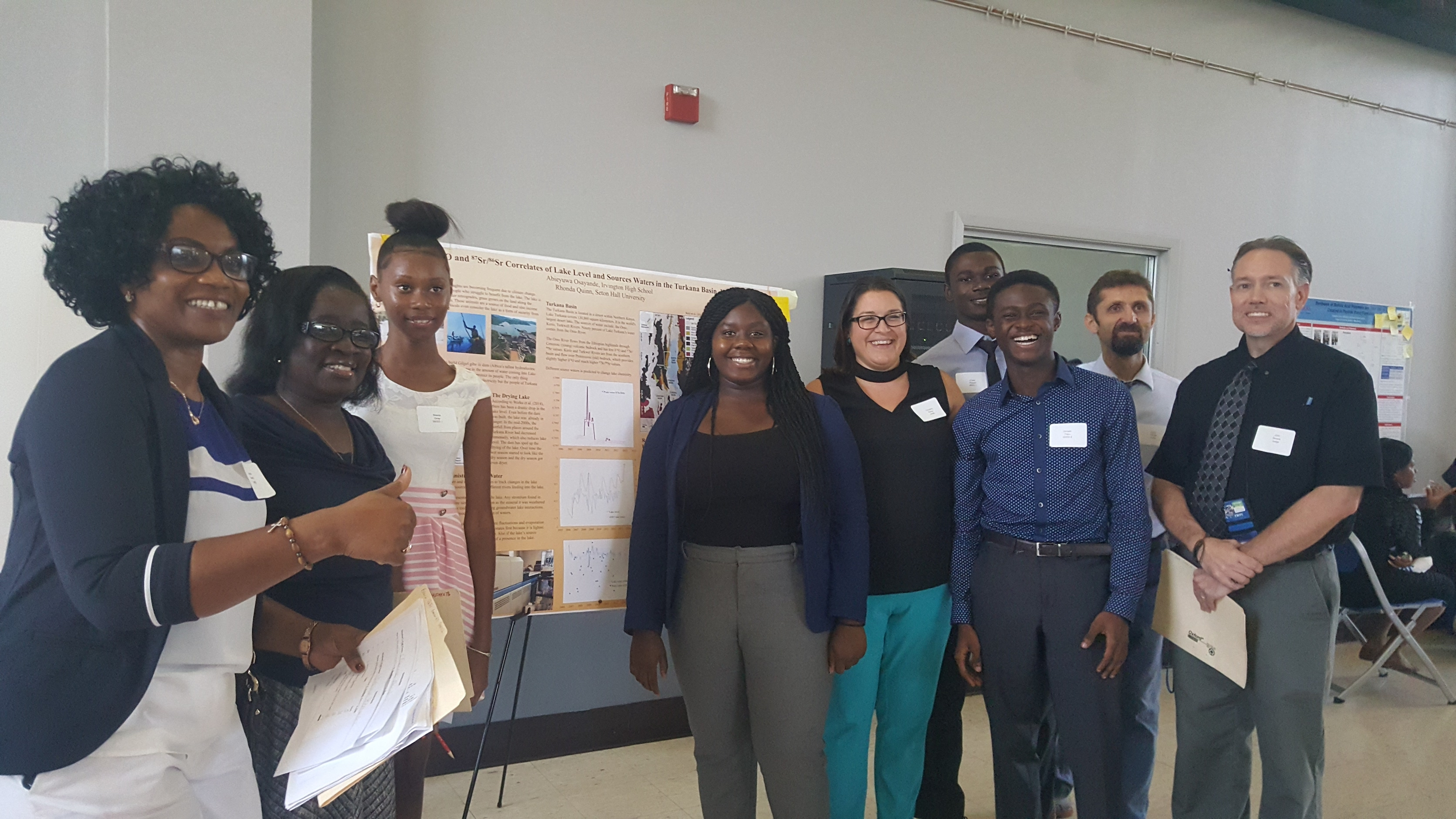 (from left) Adaeze Ihuoma (teacher and judge), Theresa Bennin (IHS coordinator and judge), Stacy Gray, Abieyuwa Osayande, Christina Rishiy (teacher and judge), Frank Peprah, Hiroshi Onyinah, Erdal Yilmaz (teacher and judge), John Severs (supervisor and judge)