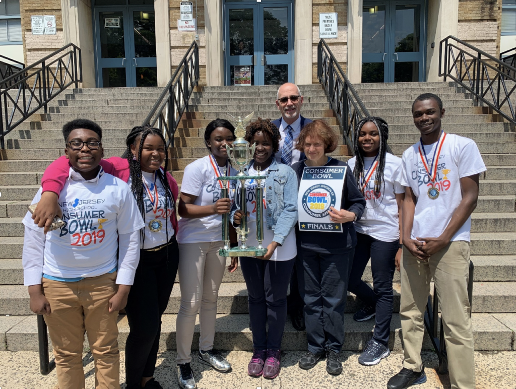 2019 Consumer Bowl Champions: From L to R: Stephen Danso, Bernice Owusu, Frank Peprah, Team Captain Eugenia Ampofo, Bolaji Falade, Adviser Joseph Romano, Team Mom Roz RosenHanst, Esther Oko, and Frank Peprah